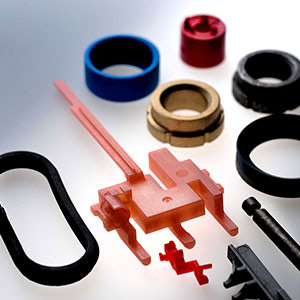 Components made of plastic and metal, coated with bonded dry film lubrication.